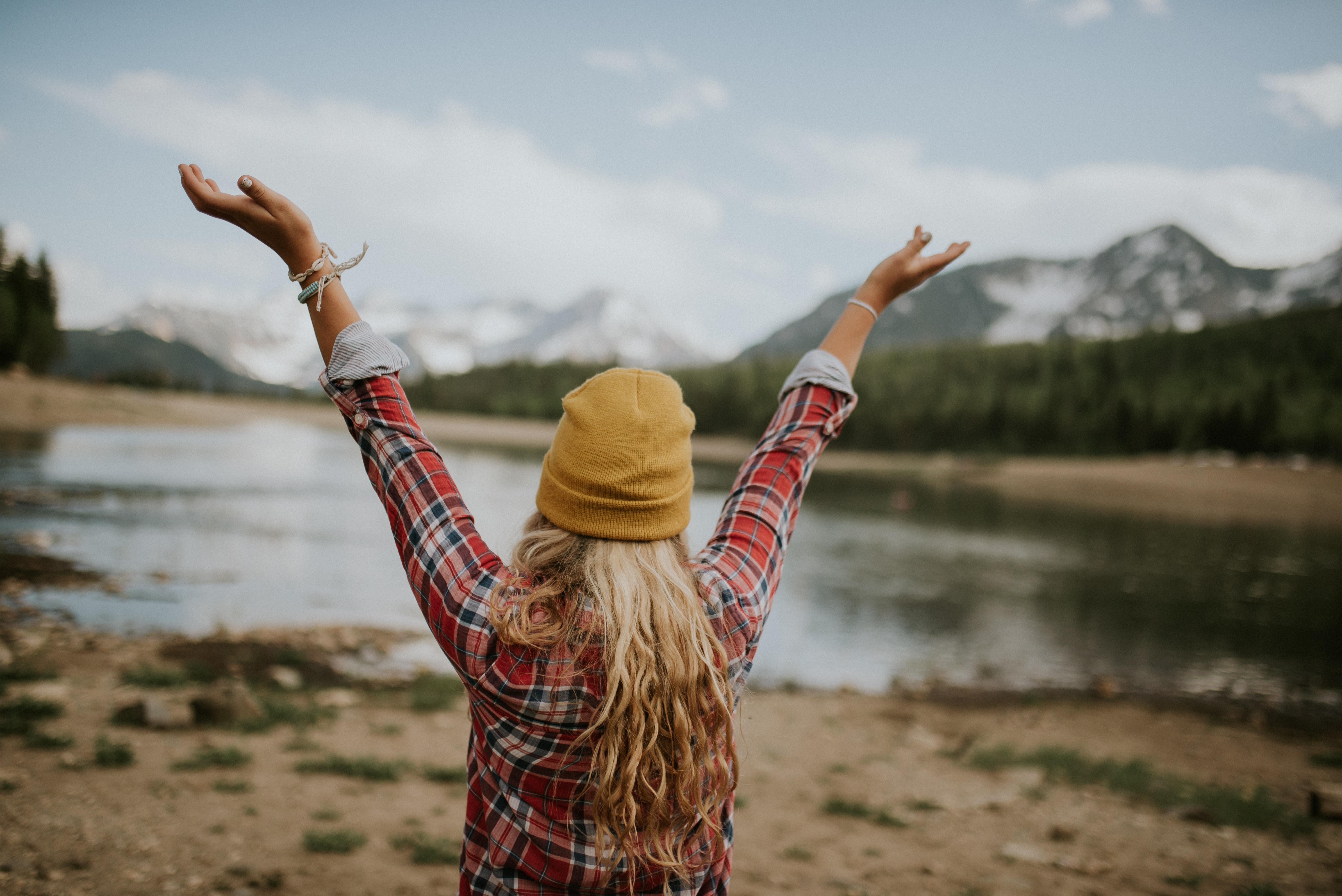woman raising arms