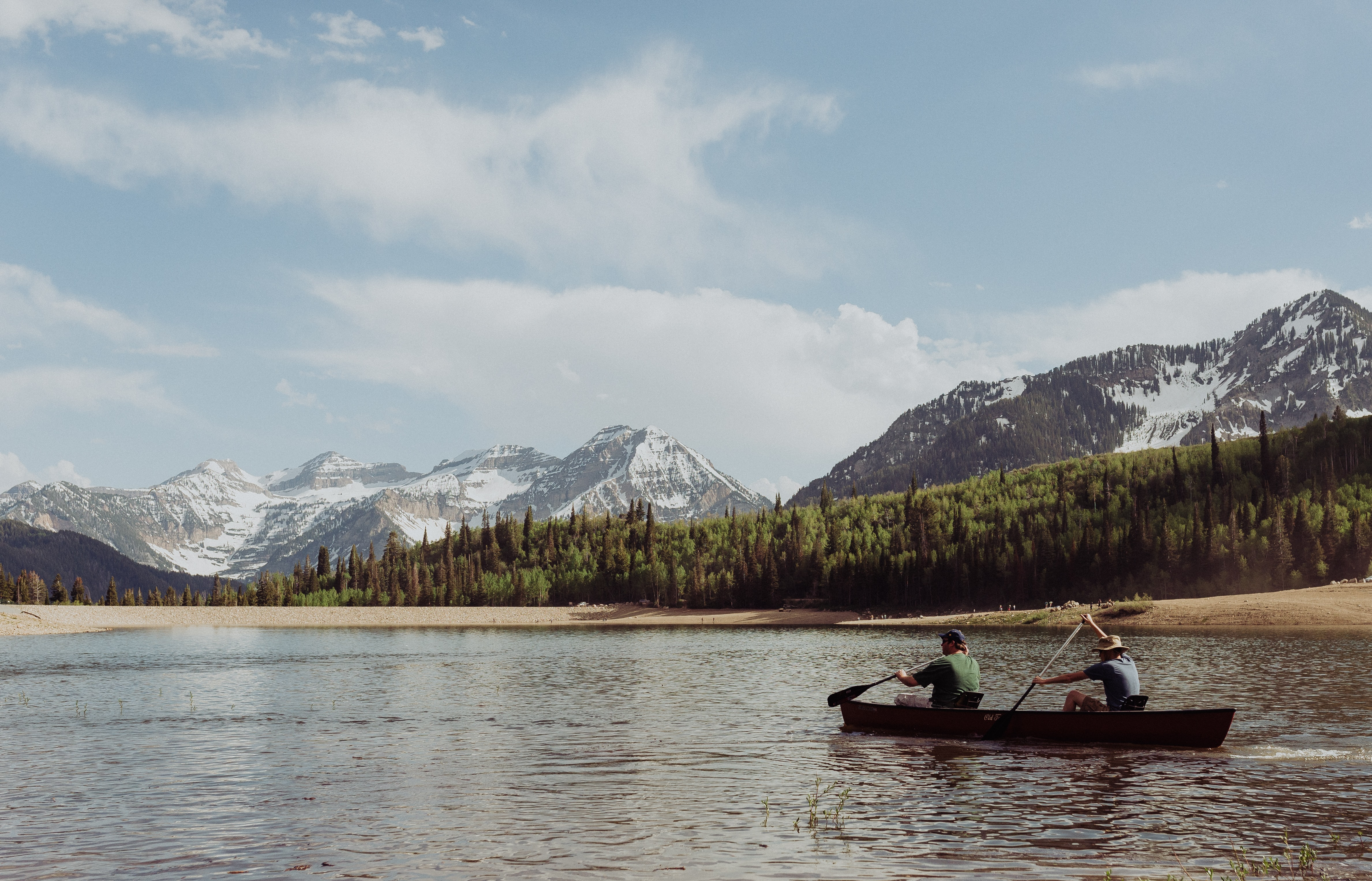 two men rowing a boat
