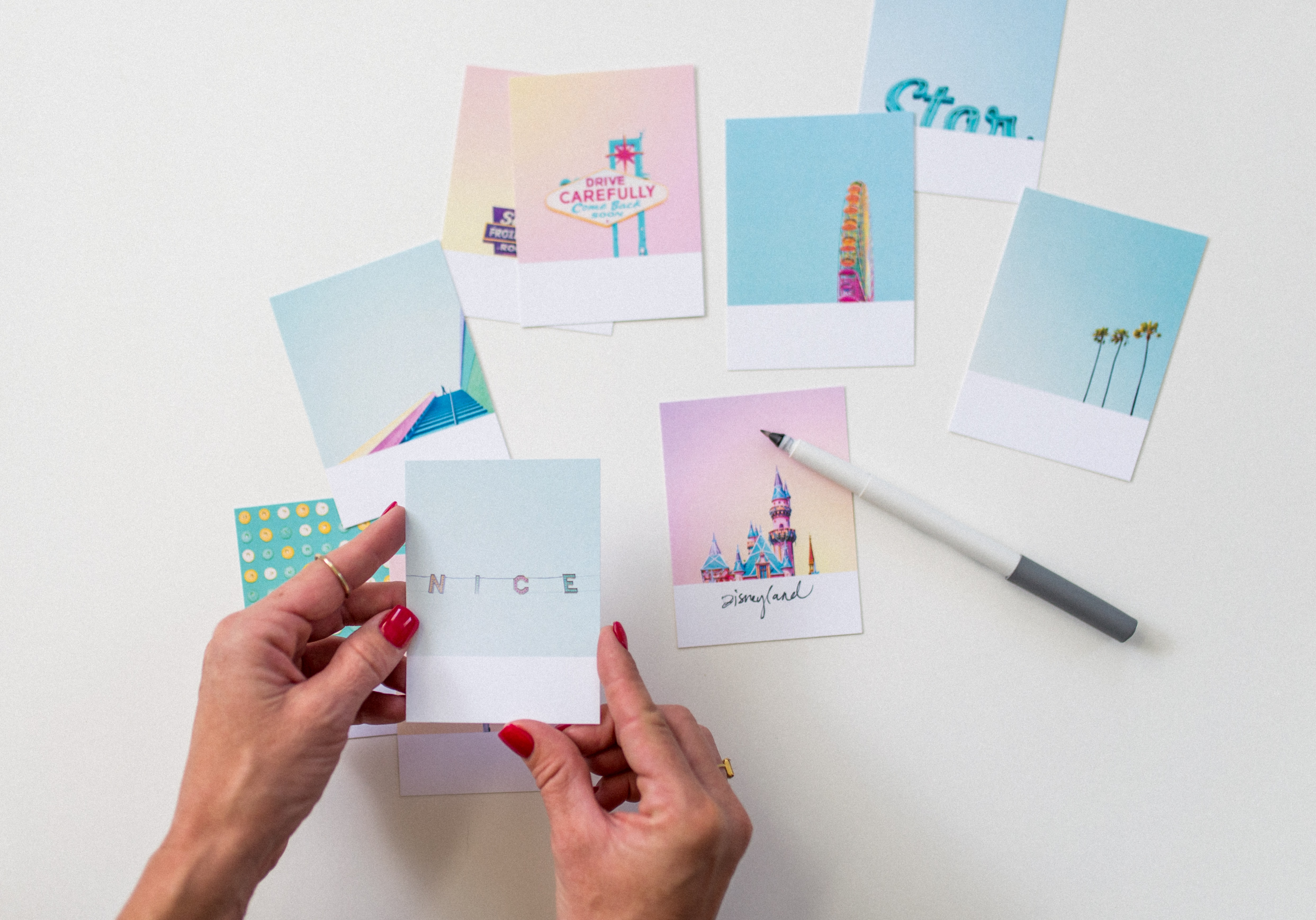 flat lay photography of person holding nice text photo paper