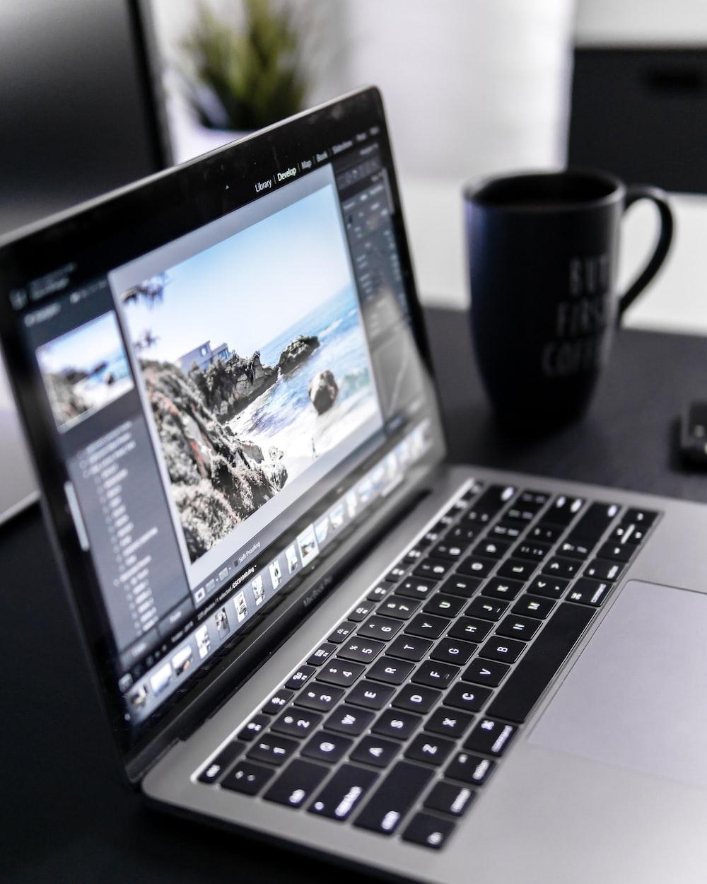 turned-on MacBook Pro on desk