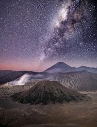 brown volcano under grey sky