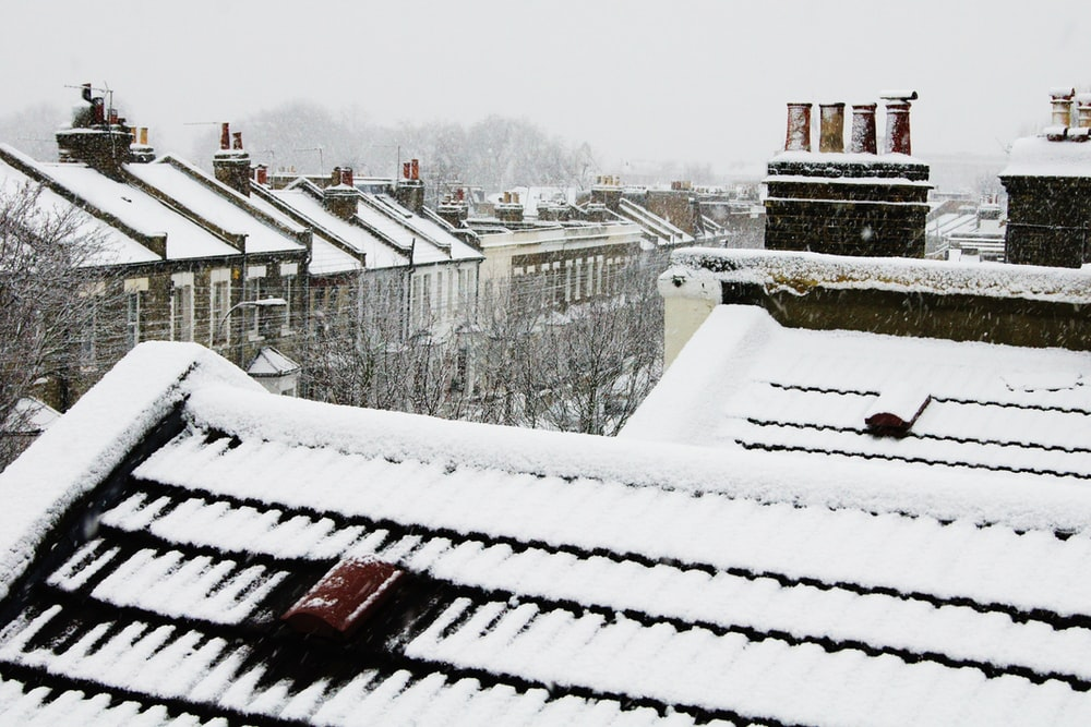 snow covered house roofs at daytime