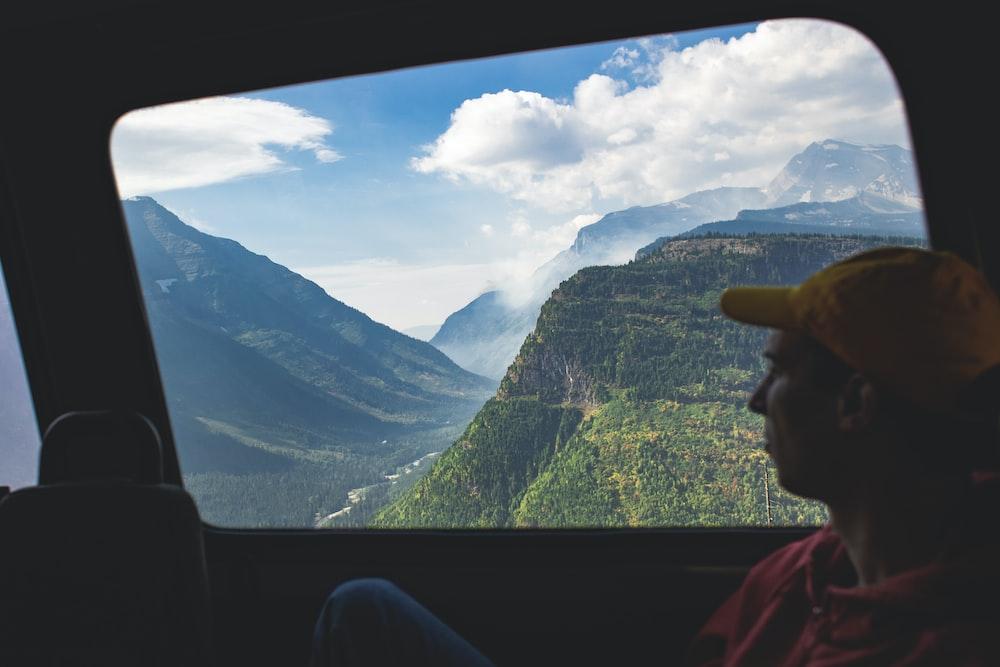 man sitting on chair inside vehicle