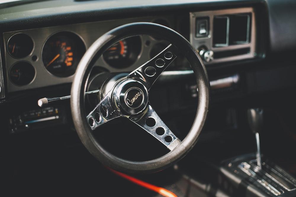 black and gray vehicle steering wheel