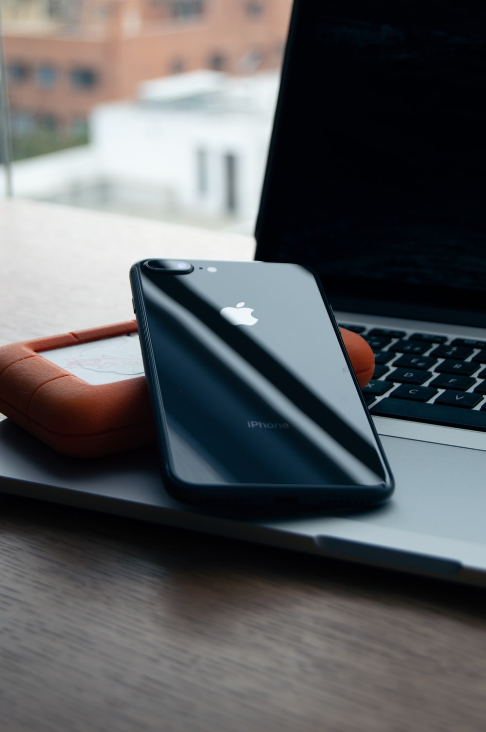 space gray iPhone 8 Plus on brown case