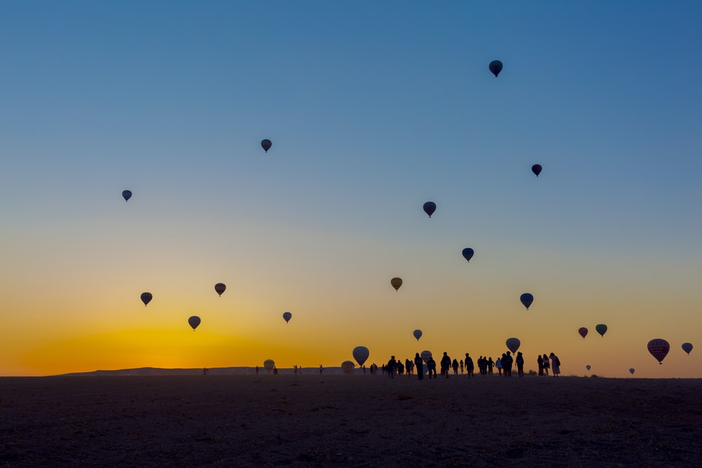 silhouette of hot air balloons