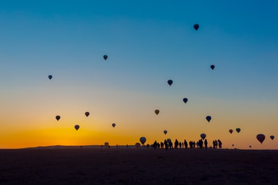 silhouette of hot air balloons amazing teams background