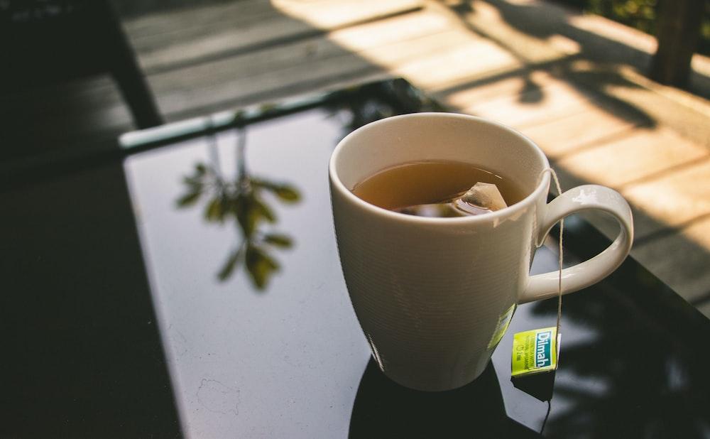 cup of tea on black panel