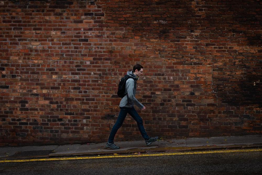 man walking in sidewalk