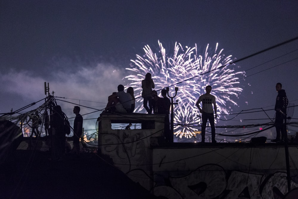 person watching fireworks display