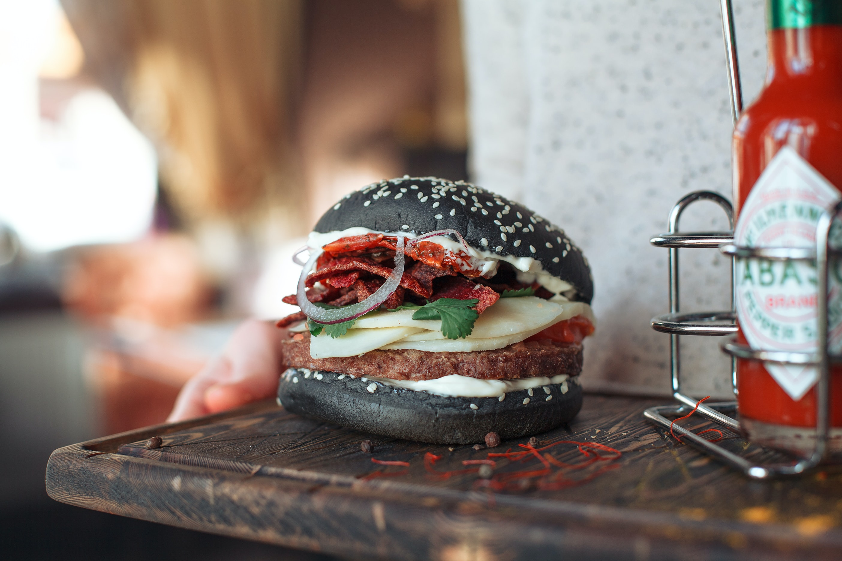 black burger with cheese selective focus photography
