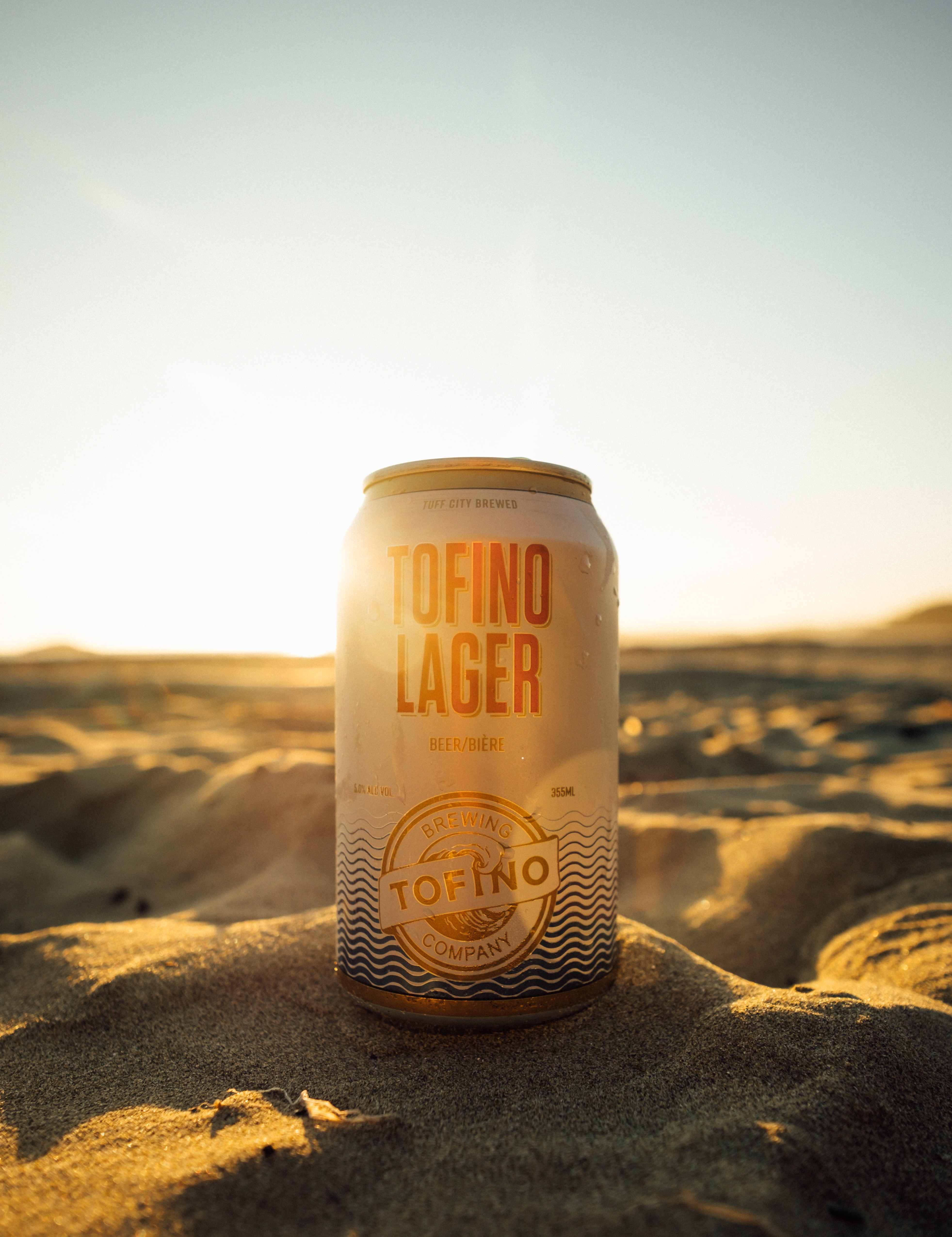 Tofino Lager beer can on sand