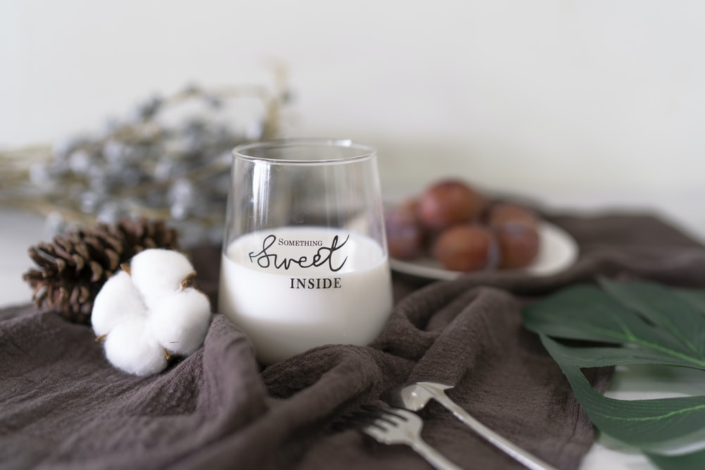 white liquid in glass cup