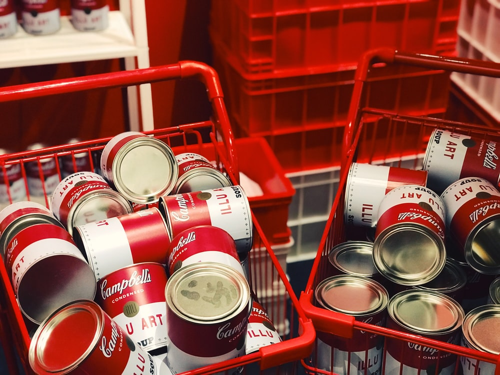Campbell's can lot on shopping basket