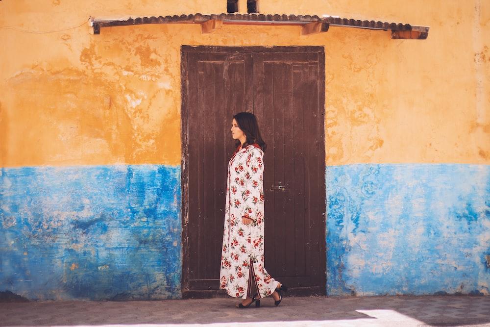 woman standing near wooden door