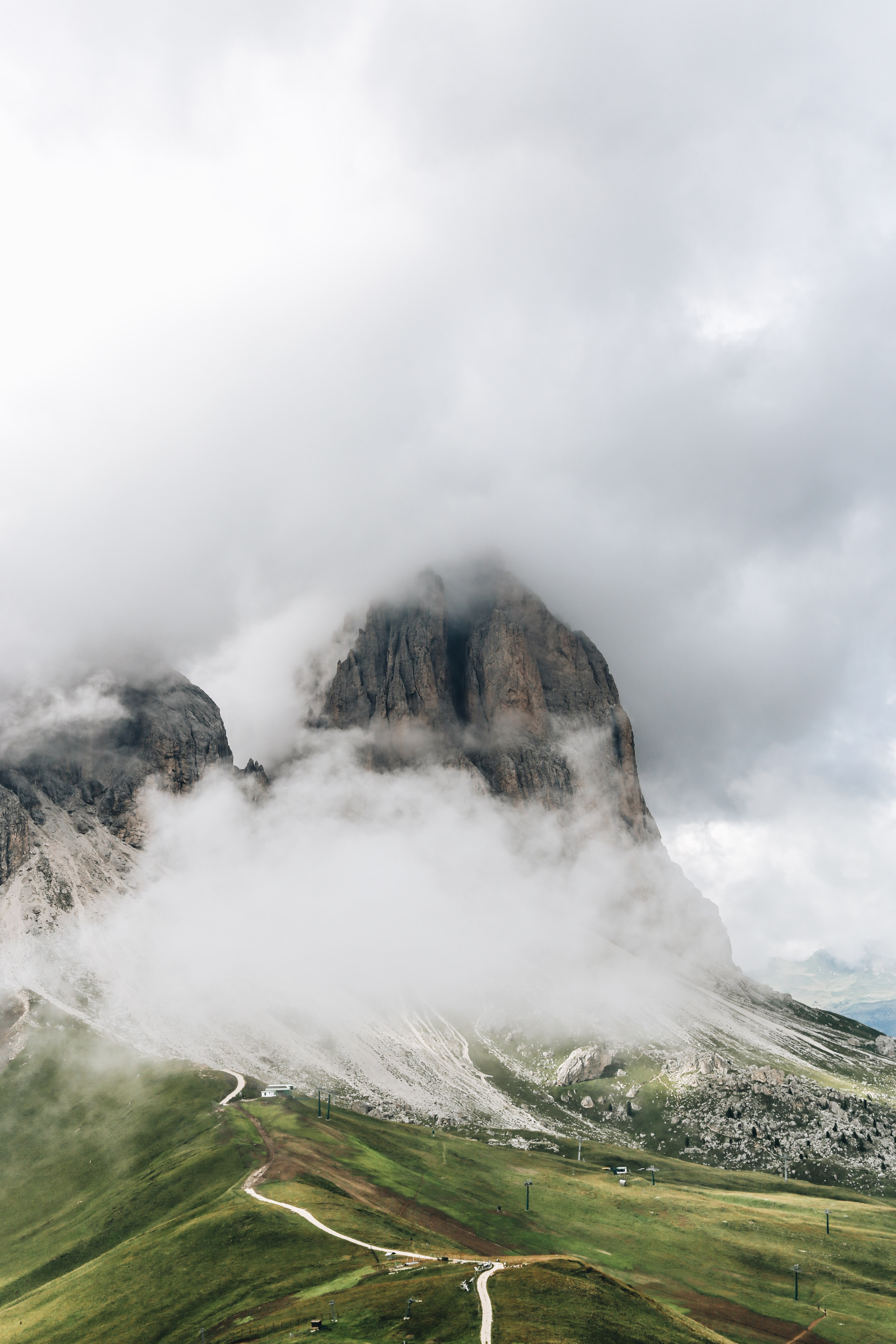 gray mountain range covered with clouds