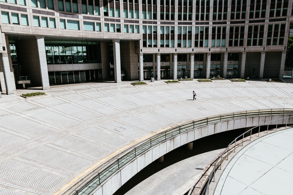person walking in concrete building