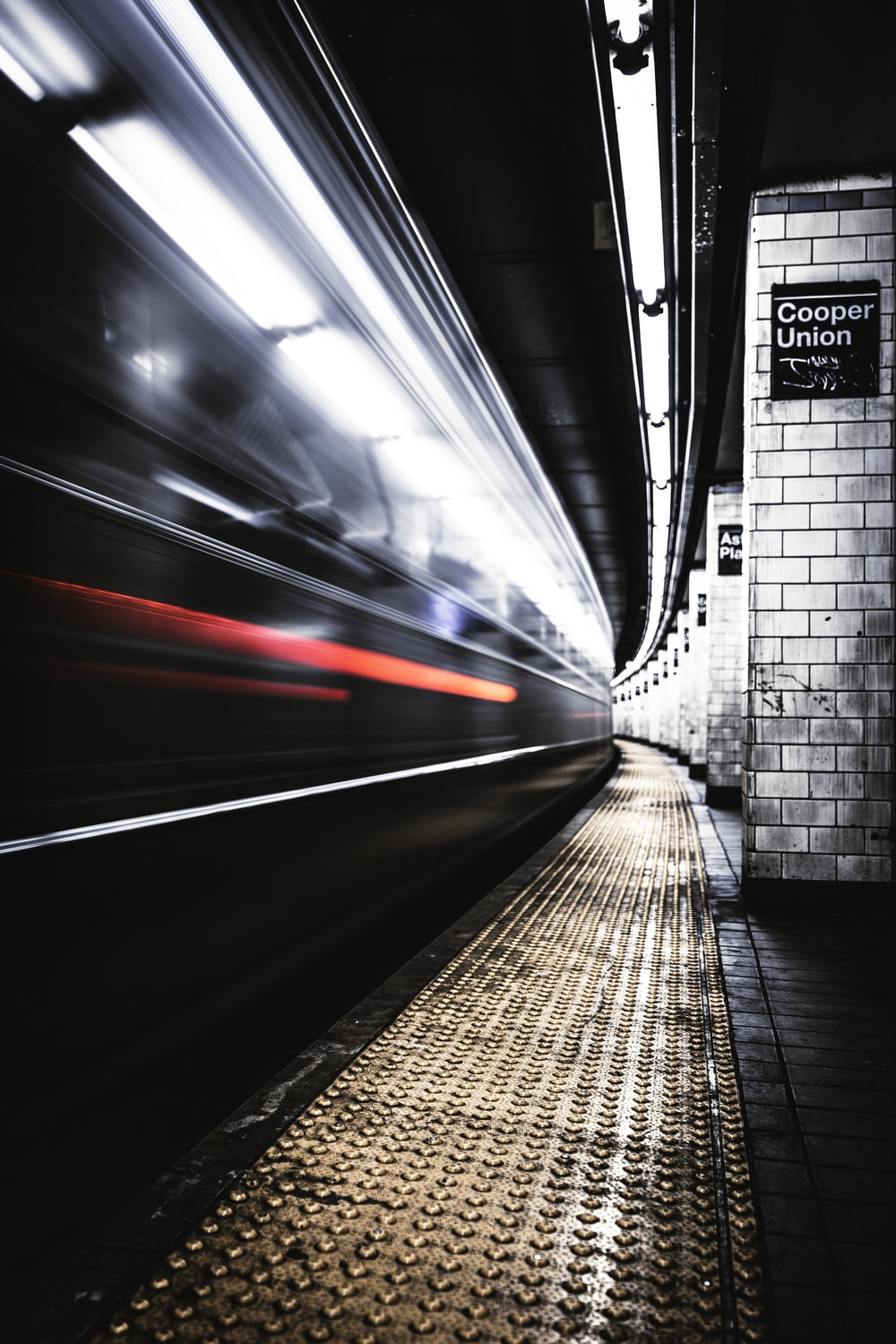 time lapse photography of train in tunnel