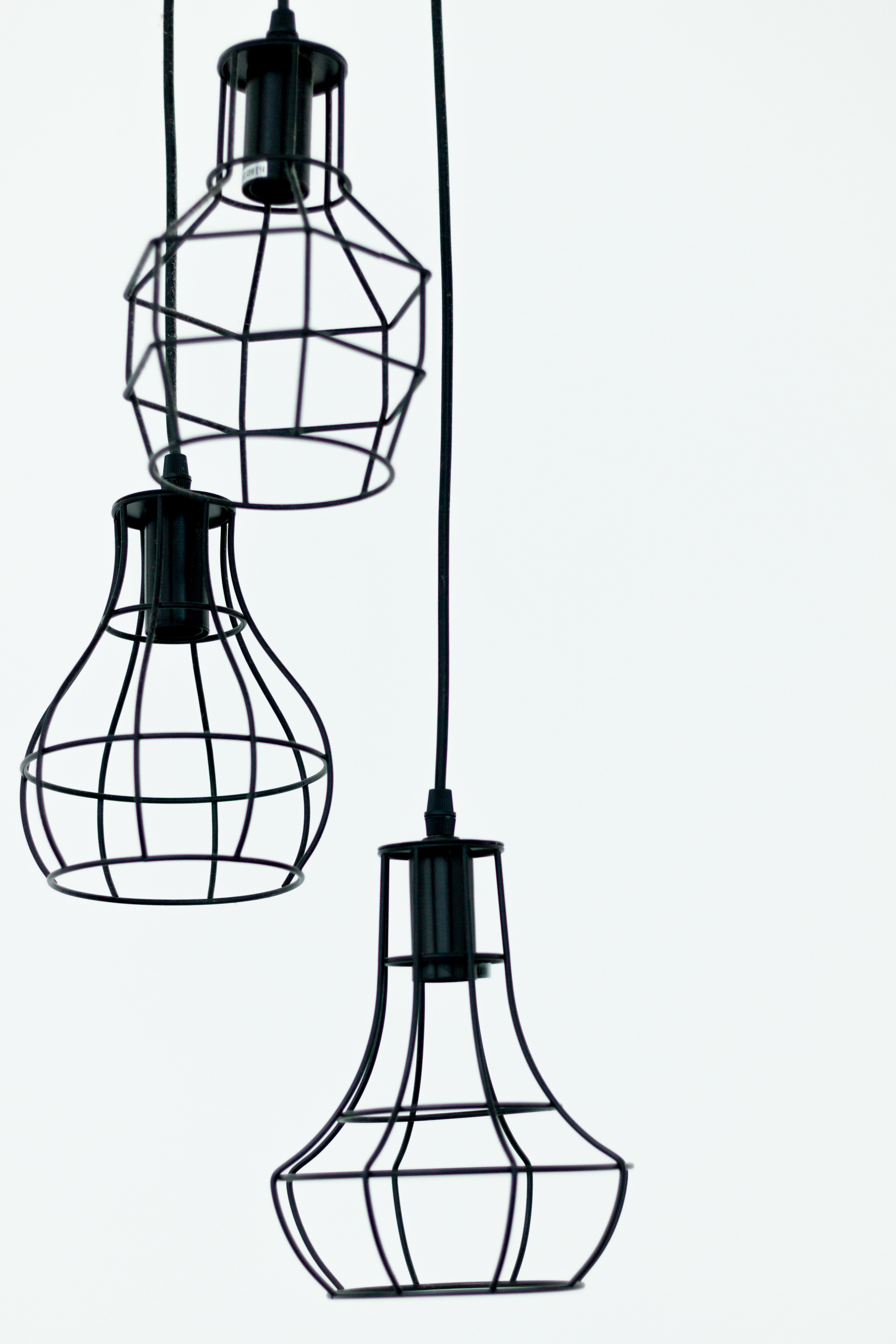 three black pendant lamps