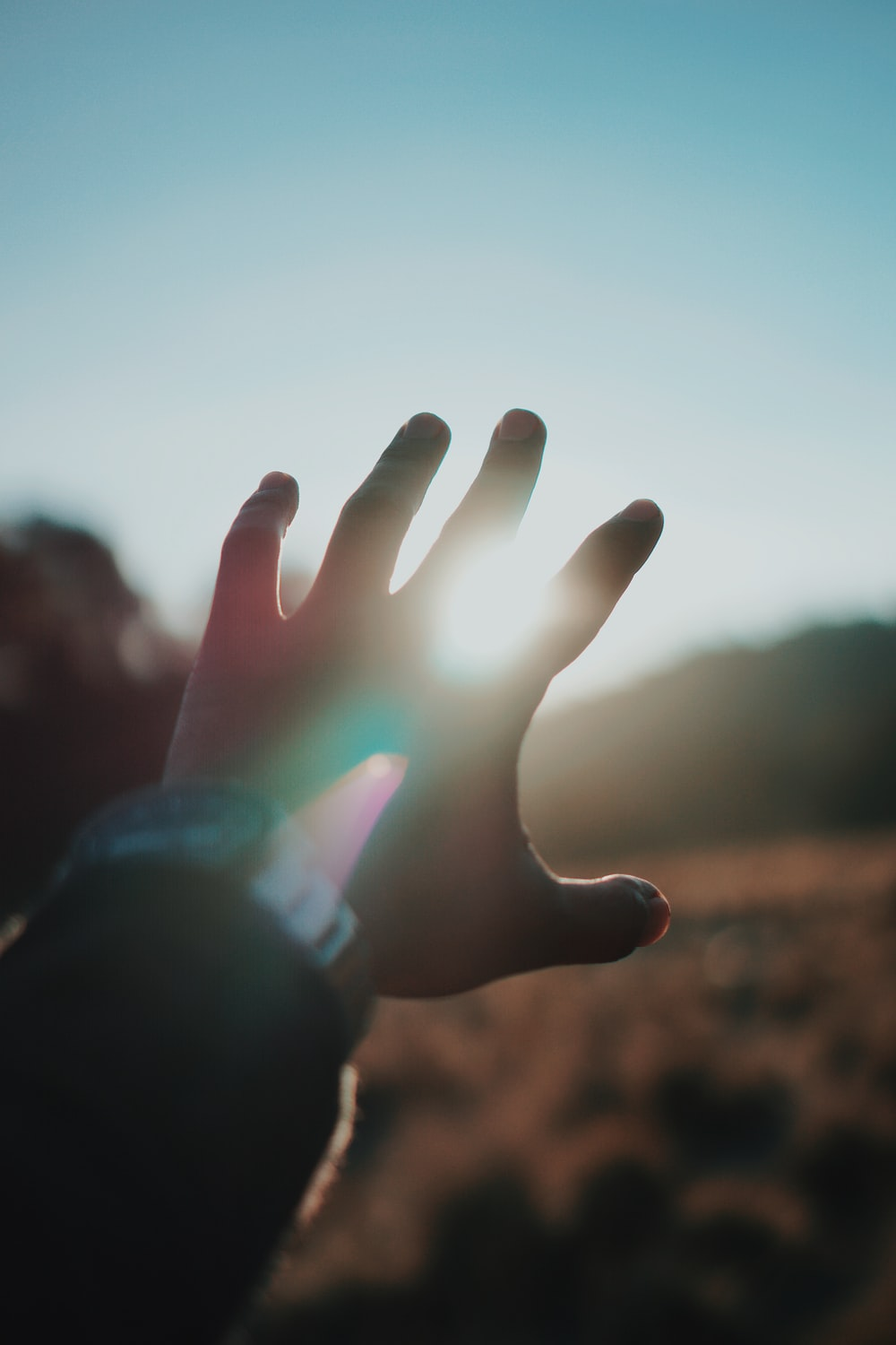 left person hand and bright light