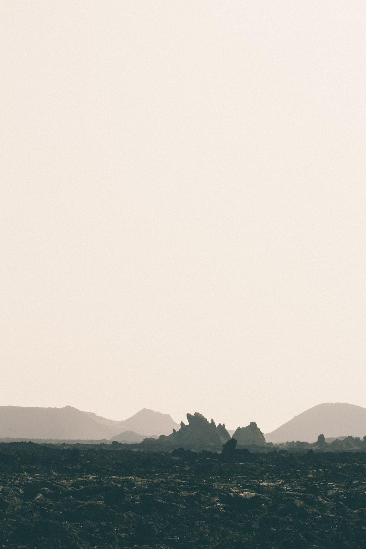 landscape photography of mountain under foggy sky