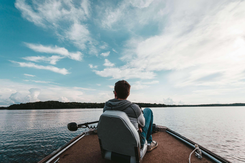man riding motorboat