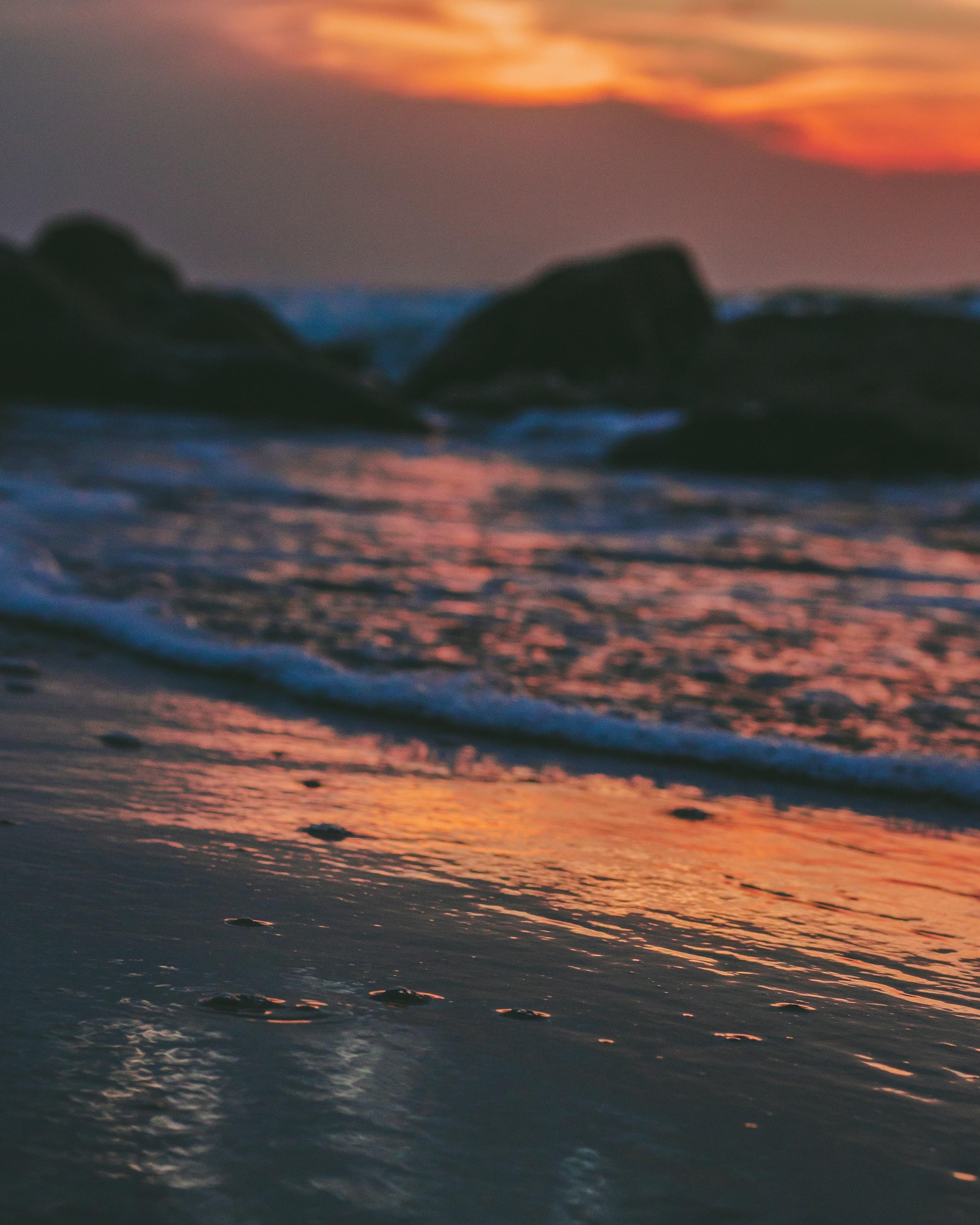 low light photo of beach