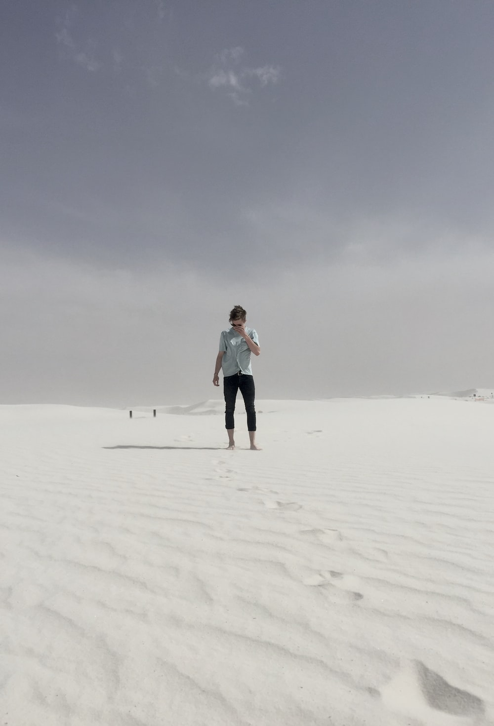man walking on desert during daytime