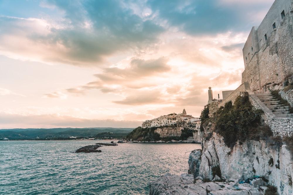 gray castle ruins beside body of water