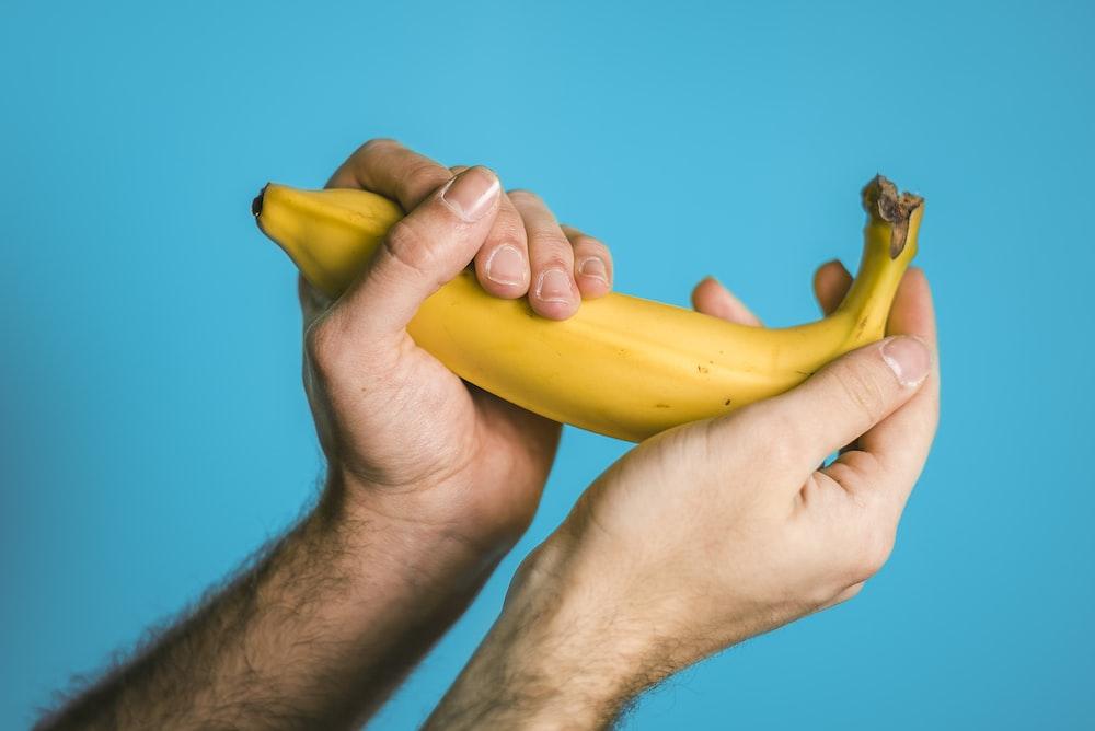 person holding banana