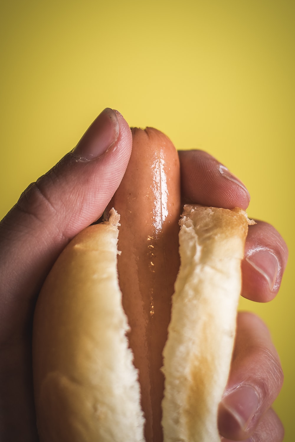 person holding sausage