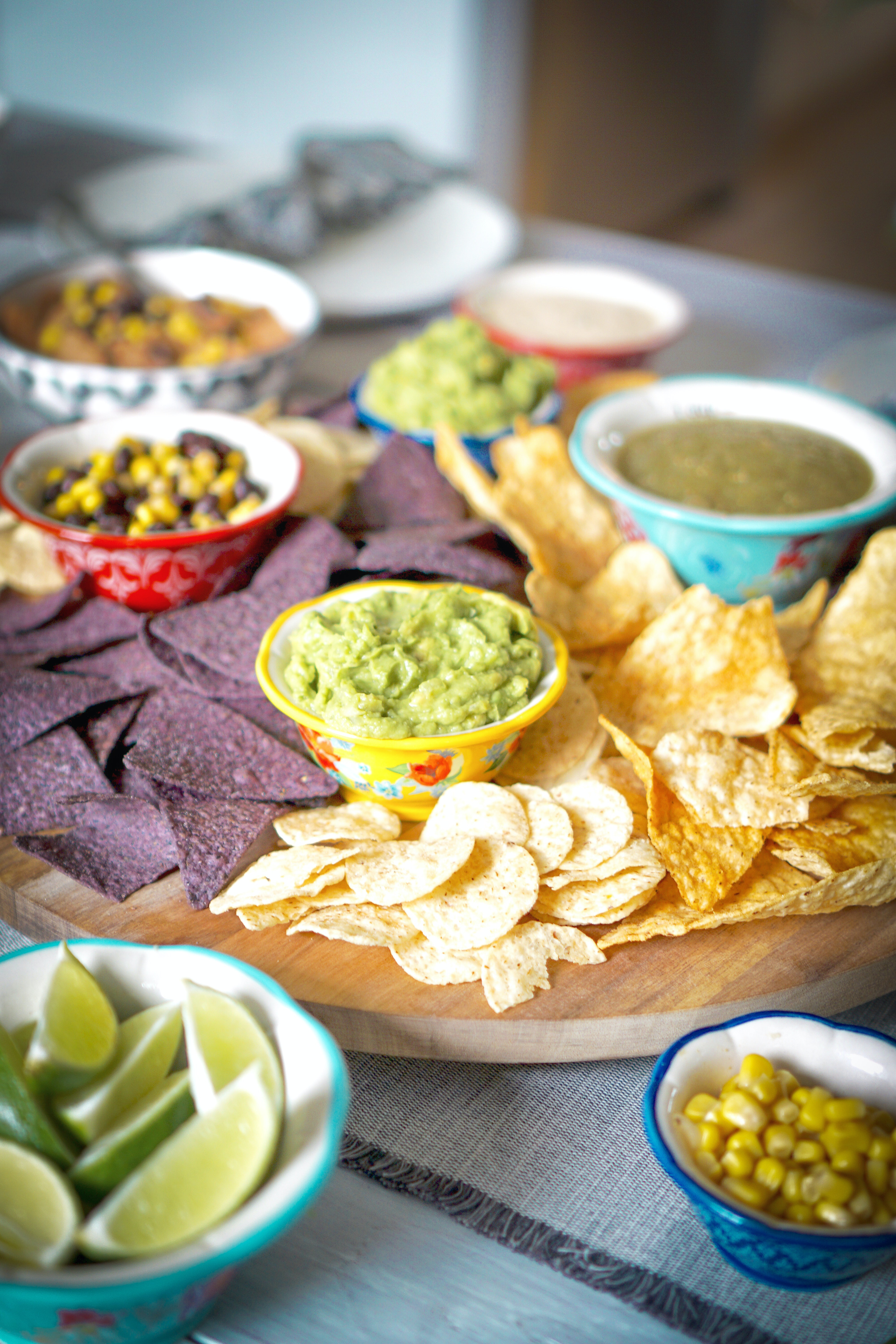 nacho chips beside limes