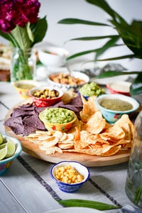 nachos on tray with dips