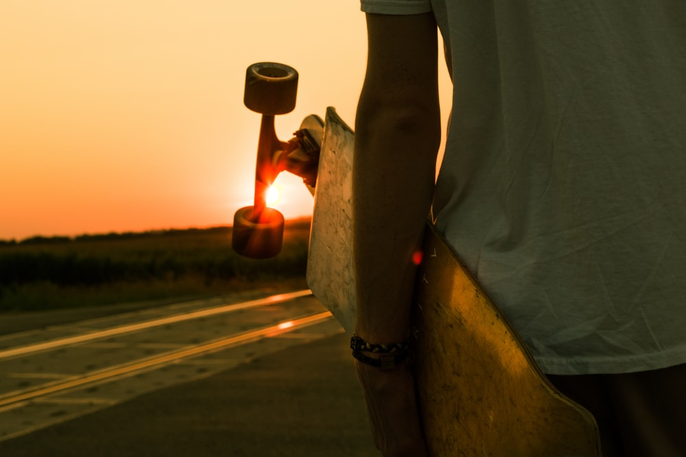 person holding longboard