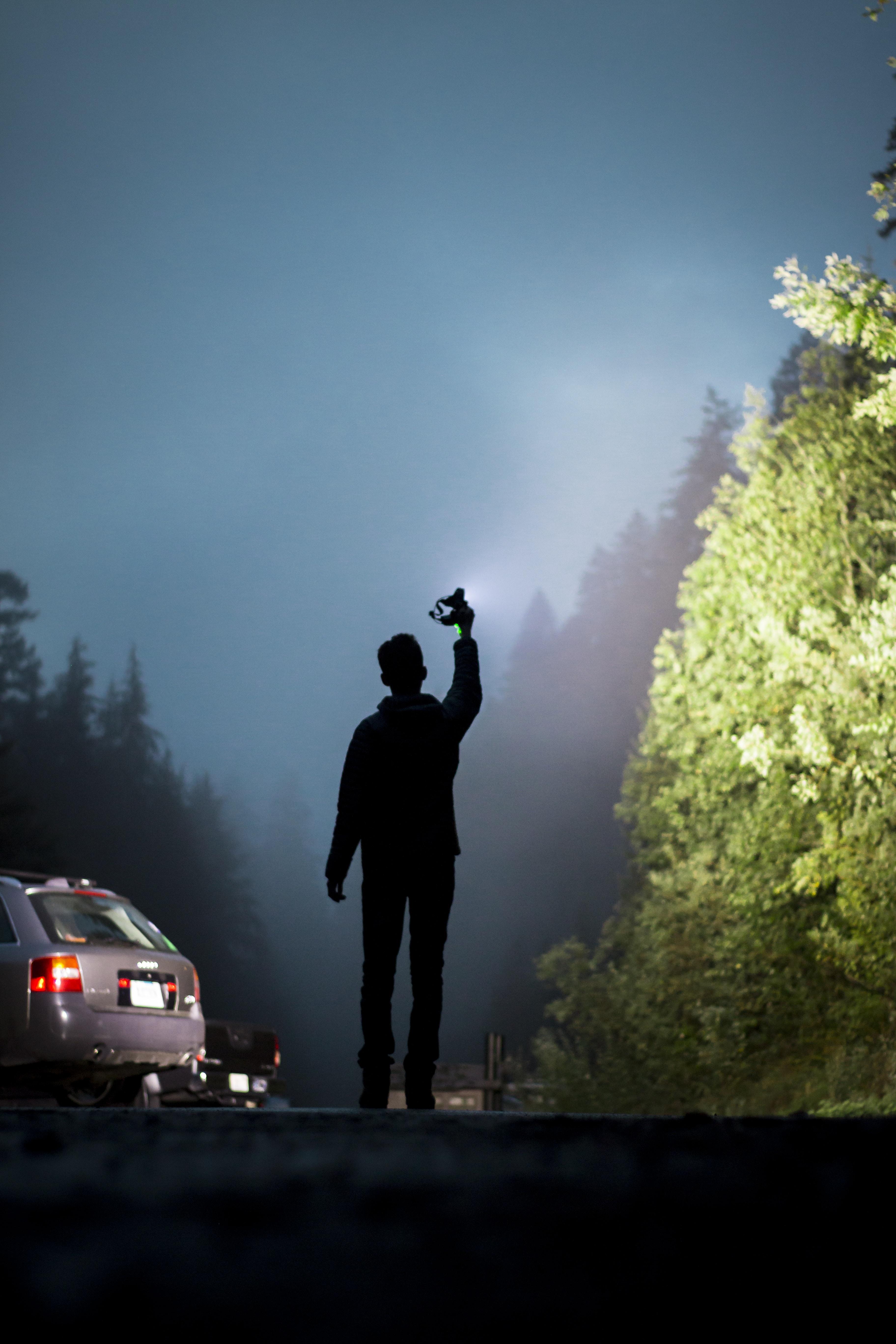 person holding flashlight