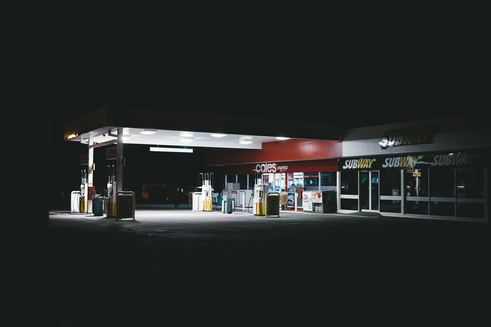 white and red gasoline station