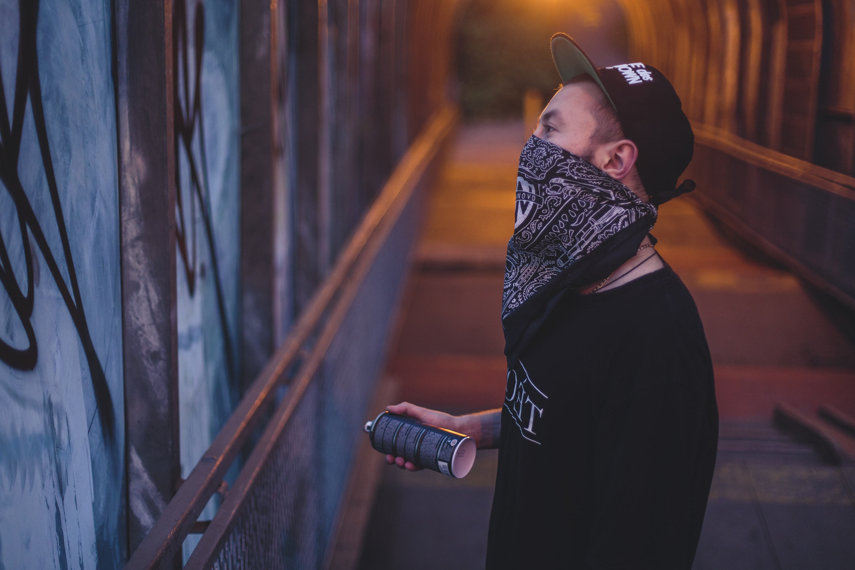 man holding spray bottle
