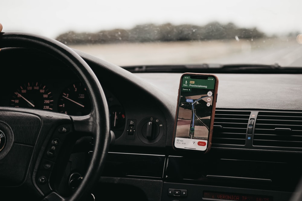 smartphone turned-on in vehicle mount inside vehicle
