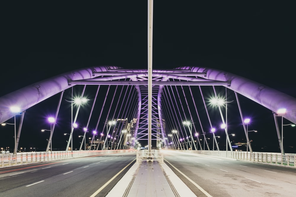 concrete bridge with lights during night