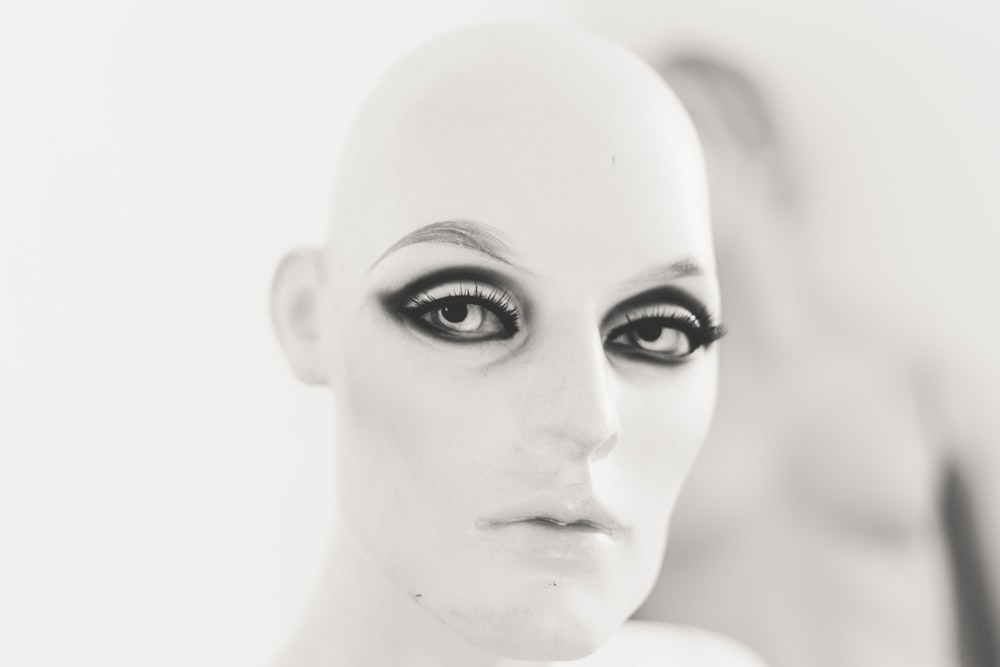 human face with black eyeshadow and mascara