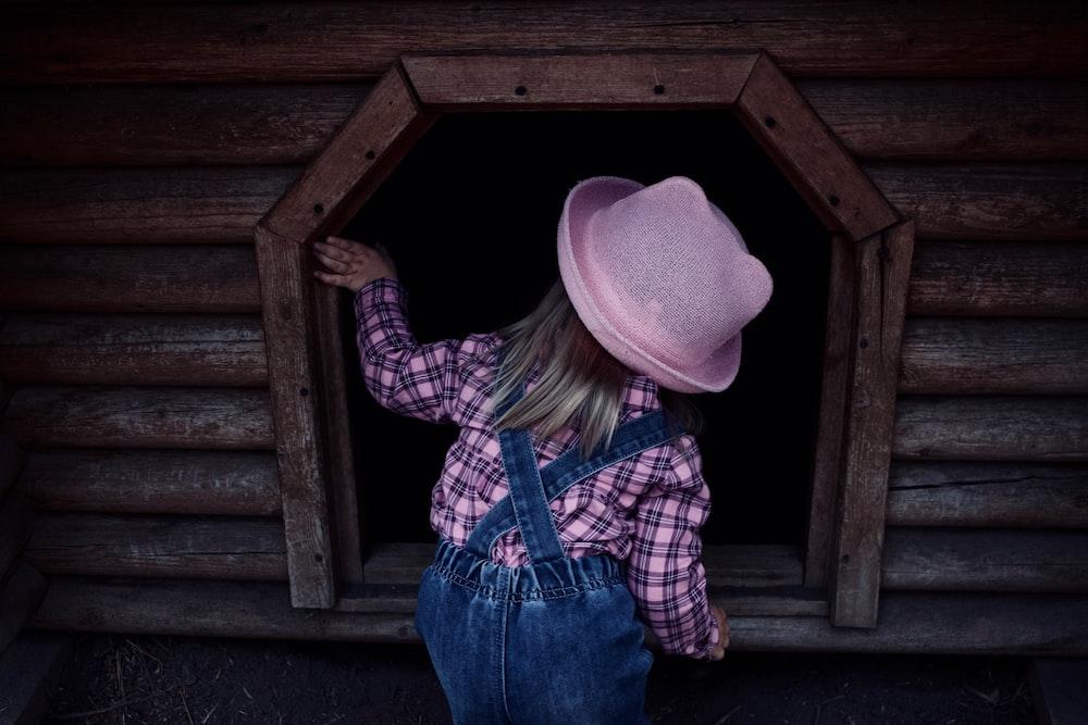 girl peeking on shed