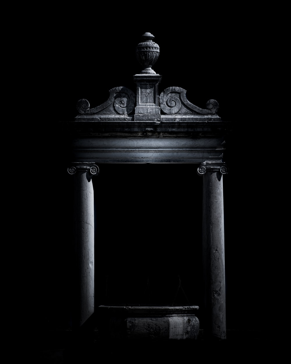 gray puja mandir altar on dark background