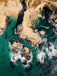 bird's-eye view photography of island near ocean