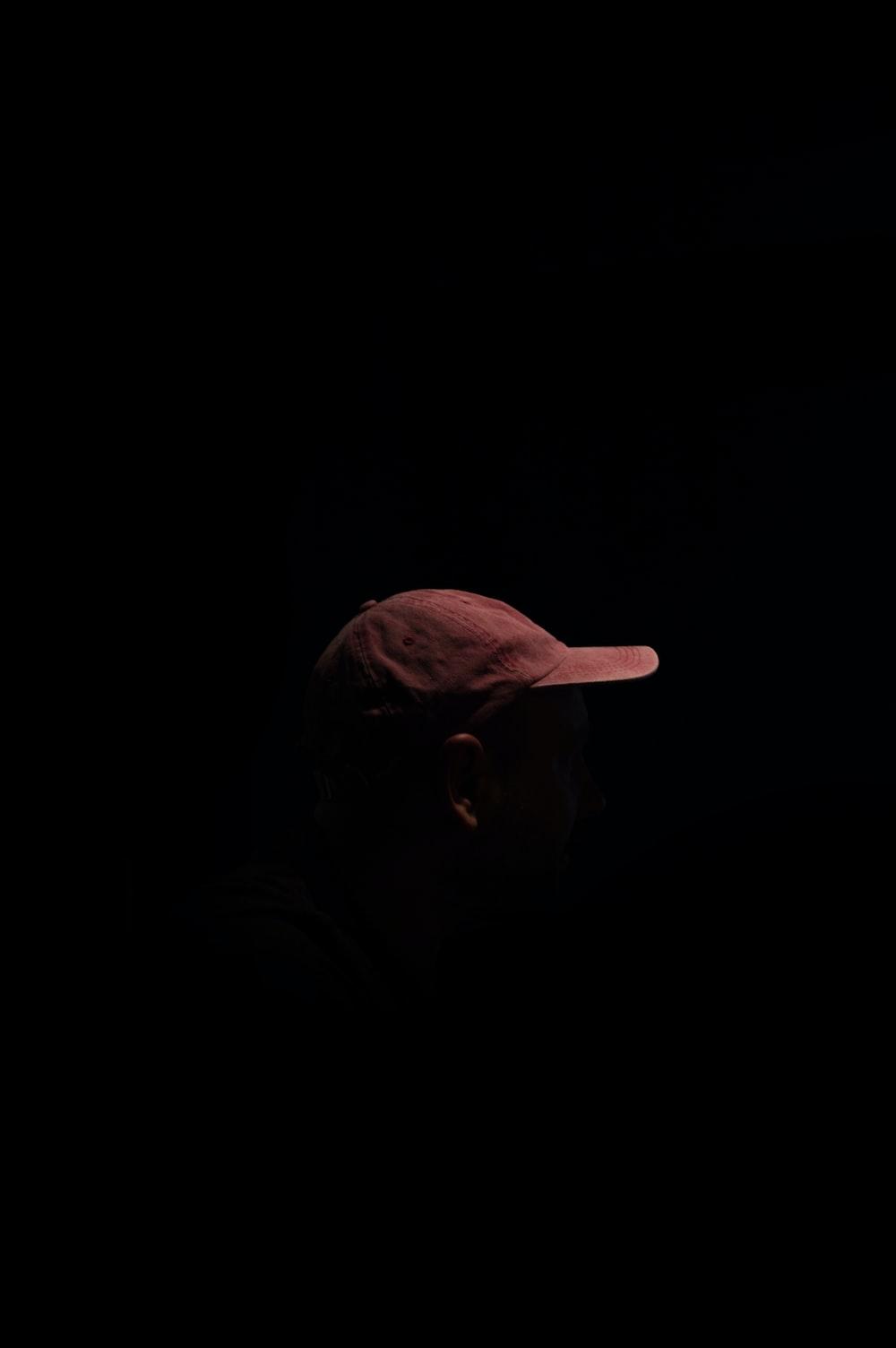 person wearing brown cap