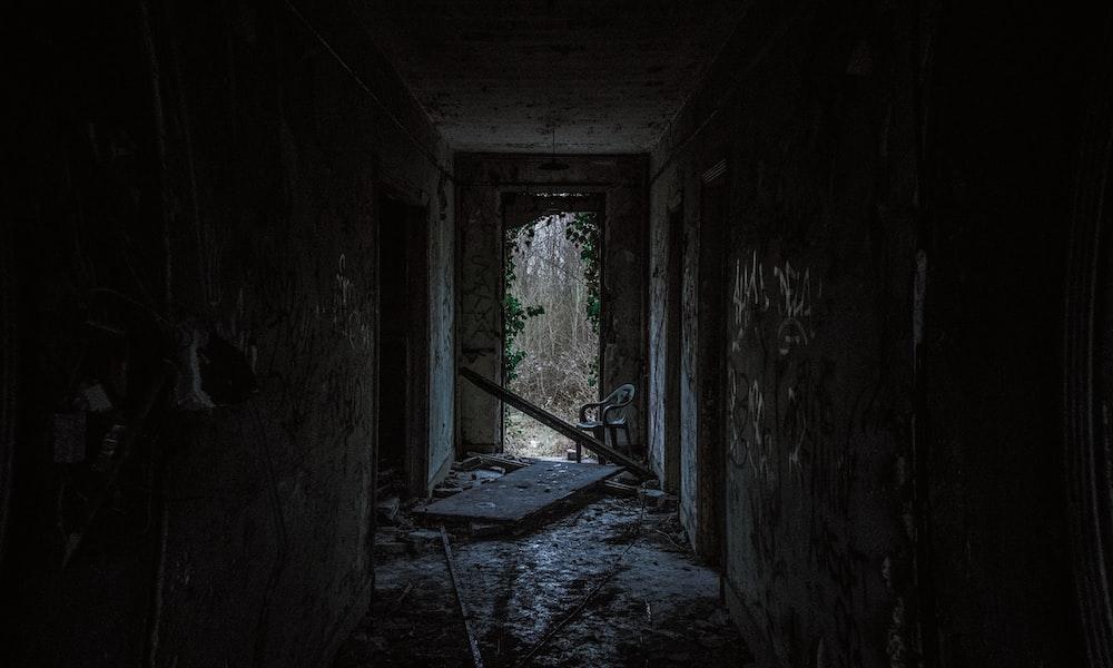 hallway between concrete walls