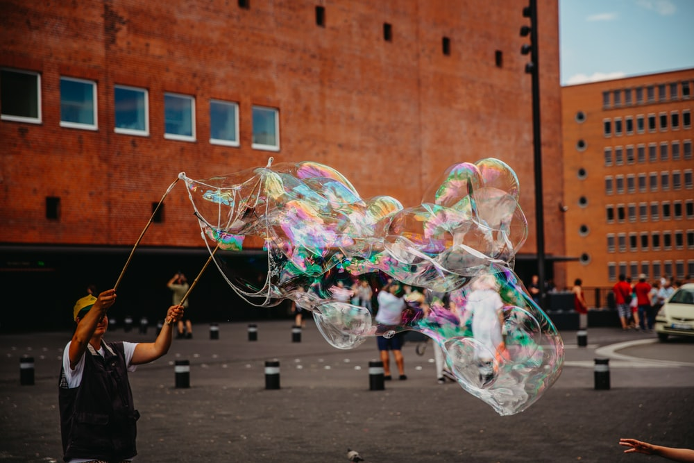 man doing bubble stunts at daytime