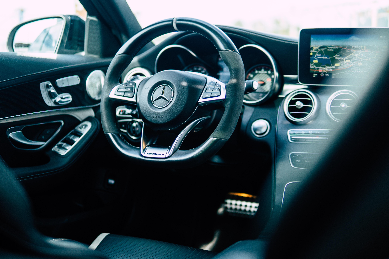 black Mercedes-Benz car steering wheel