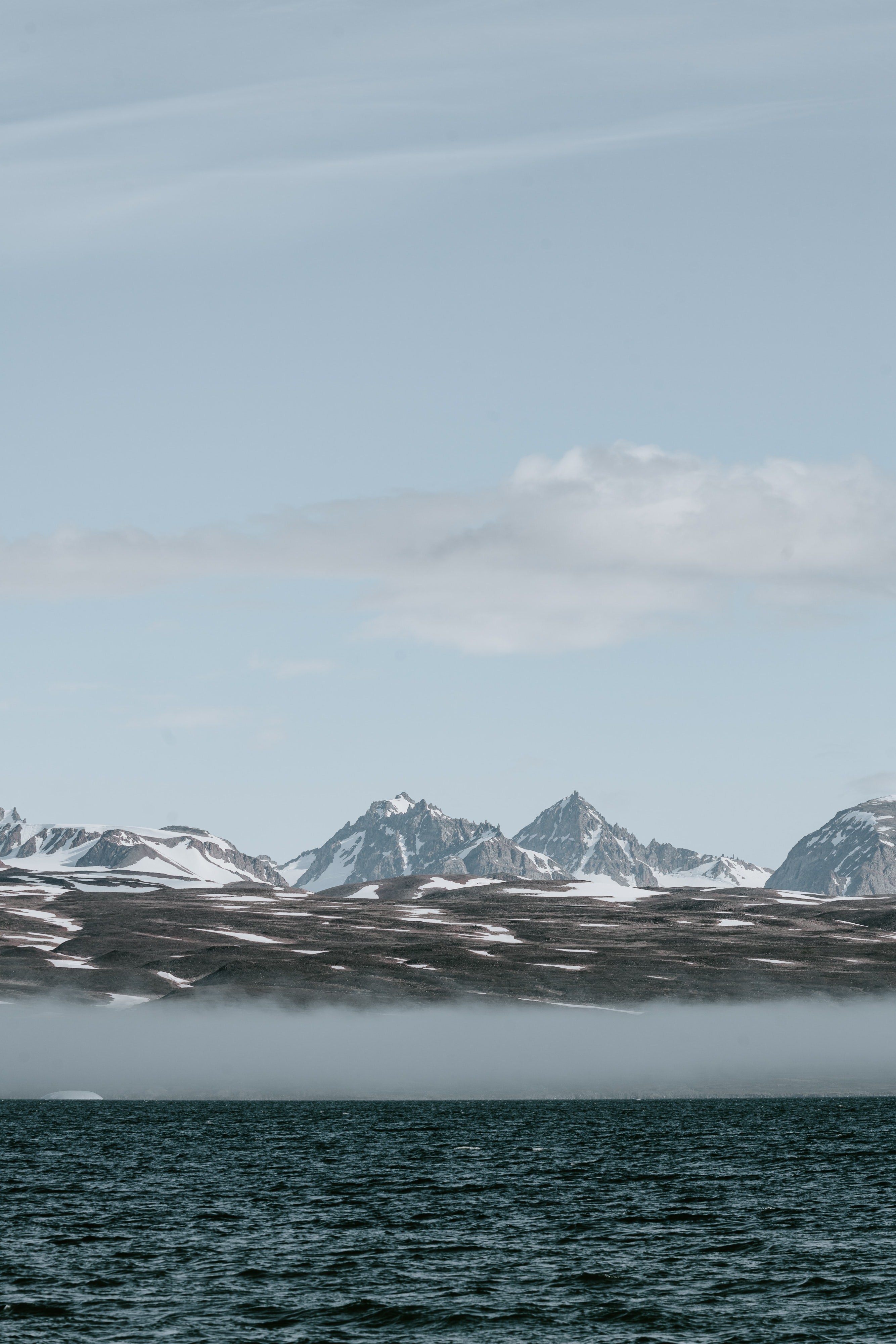 mountains beside body of water