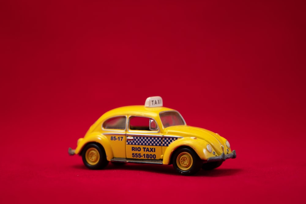 yellow Volkswagen Beetle coupe
