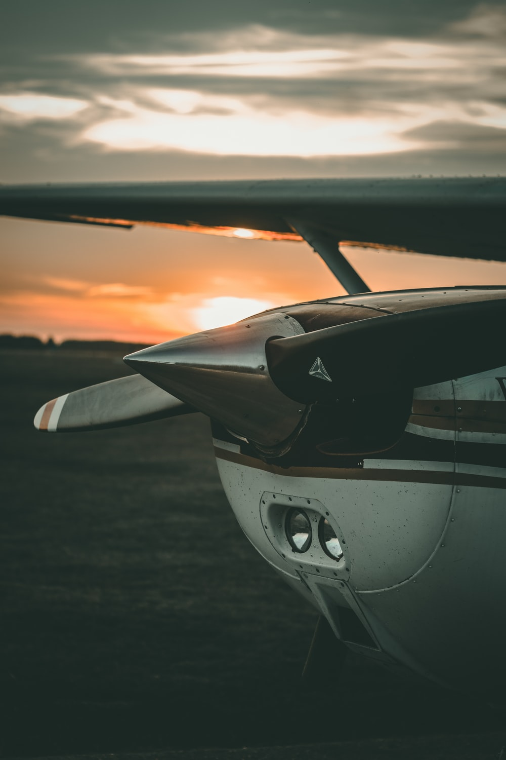 close-up photography of brown and white plane during sunrise